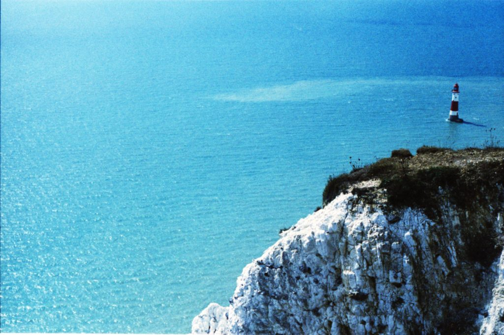 beachy head lighthouse in blue